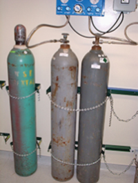 gas cylinders chained to a wall