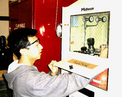 researcher using gas cabinet