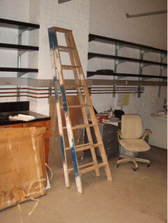 wooden ladder leaning against wall
